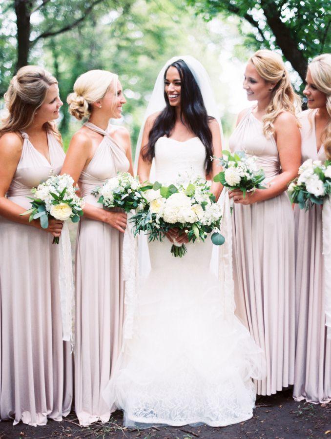 Convertible bridesmaid gowns: http://www.stylemepretty.com/2016/06/21/former-miss-nebraska-usa-shares-her-hometown-wedding/   Photography: Megan Pomeroy Photography - http://meganpomeroyphotography.com/