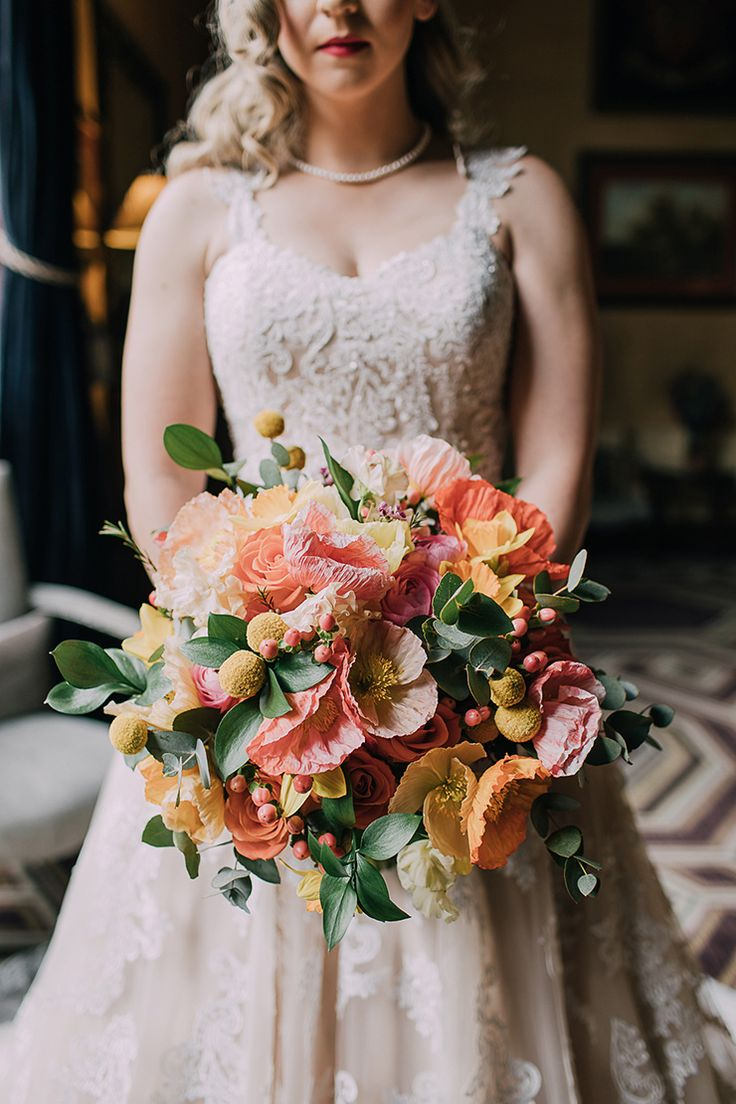 Pink, orange and yellow wedding bouquet with poppies, billy buttons, roses and hypericum berries   Event Photography & Videography