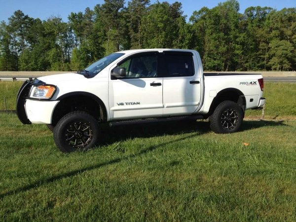 Awesome Nissan Titan with suspension lift kit, wheels, tires, grille guard and more.