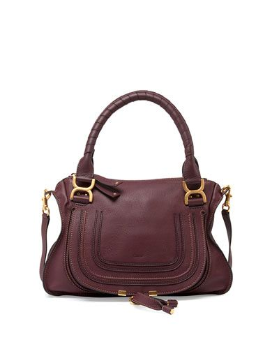 "Chloe pebbled leather satchel bag. Golden hardware. Wrapped top handles with bow buckles; 6"" drop. Detachable shoulder strap; 19"" drop. Pintucked flap front with tassel detail. Zip top closure. Cotton"