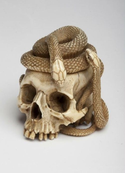 Netsuke skull with snakes, made in Japan in the 19th century...