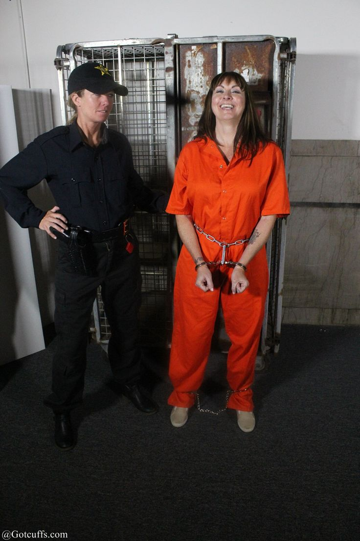 Lauging woman shows how much fun wearing handcuffs and leg ...