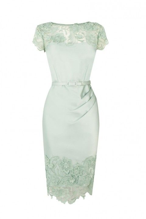 This mint green dress is the perfect outfit for a guest at a wedding.