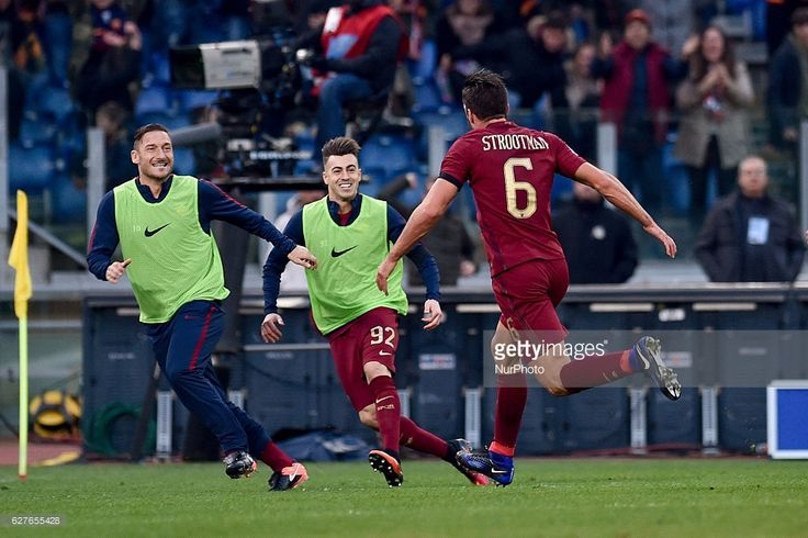 Kevin Strootman of Roma celebrates with Francesco Totti scoring first goal during the Serie A match between Lazio v Roma on December 4, 2016 in Rome, Italy.