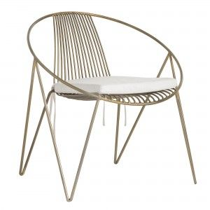 Our Ginger Chair pairs a Scandinavian frame with a contemporary antique brass finish. An iron frame means the piece will last, unlike similar styles made from low grade materials. Perfect when flanked with a diminutive drink table or across a desk in a chic office setting. Comes with a removable, off-white linen cushion with ties.