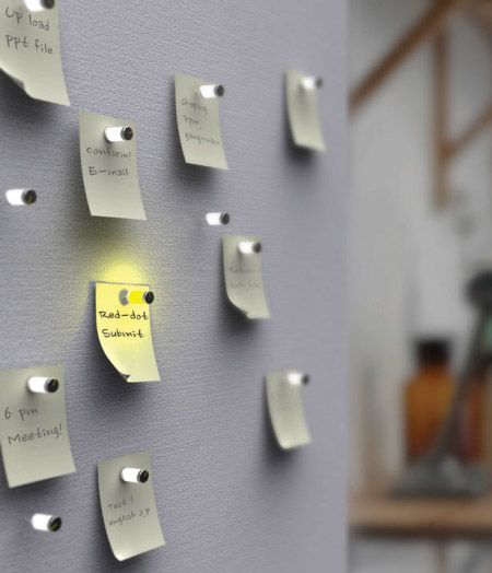 A pushpin that lights up when you need to read a memo. Great concept, don't own a corkboard though....
