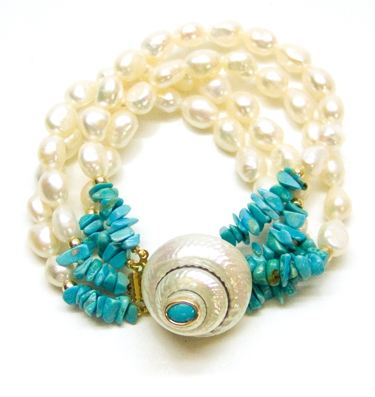 Helga Wagner Fresh Water Pearls with Turquoise chips and white Turbo Shell clasp with Turquoise Cabochon set in 14 K gold.