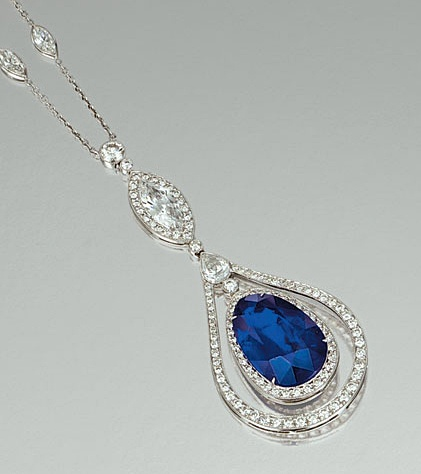SAPPHIRE AND DIAMOND PENDANT NECKLACE    The fine curb link chain spectacle-set with marquise-shaped diamonds, suspending a similar larger stone bordered by brilliant-cut stones, terminating on a open work drop, the frame set with pear-shaped and brilliant-cut diamonds, to the pear-shaped sapphire swing centre, mounted in white gold,    length approximately 410mm.