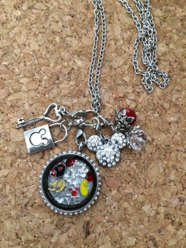 This is a Inspired Memory Locket. This locket is a twist, not magnetic. So it will not just come open if you move the wrong way The locket is a 30mm (larger locket) and it comes with a 30 inch chain.