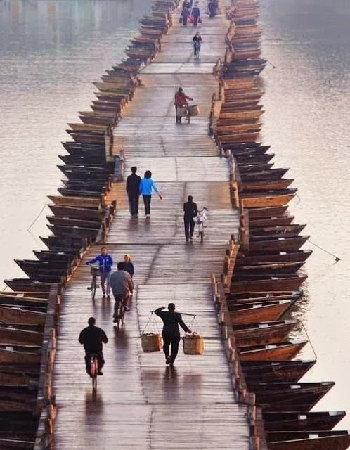 Wooden Boats Bridge, China >>> very cool