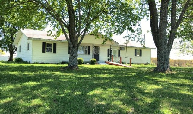 Country home on PRISTINE pasture acres with a STOCKED POND only 10 minutes from Houston, MO! Barn is 5 years old with an auto-waterer & corrals for working LIVESTOCK. The 6-WIRE fencing & cross-fencing is in great condition! In the backyard you will find a fenced & fertilized garden spot, many apple trees, peach trees, pear trees, two small vineyards & a blackberry patch. There is also a small cottage that could be used as a GUEST HOUSE as well! Owner financing is available with approved…