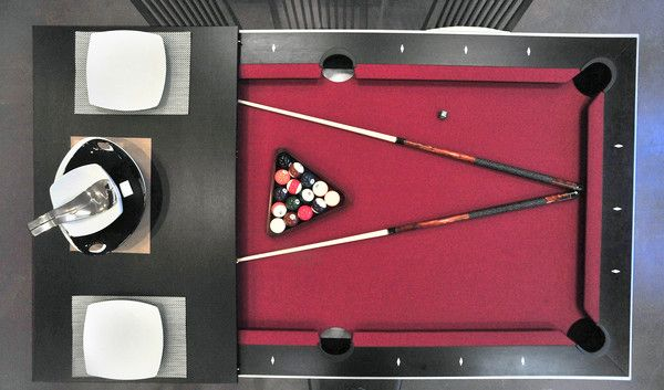"""The Aramith """"Fusion Table"""" doubles as pool table and dining room table. Three panels across the top can be removed to reveal the playing surface beneath. The table costs $6,188 and is available at Pad in Fells Point."""
