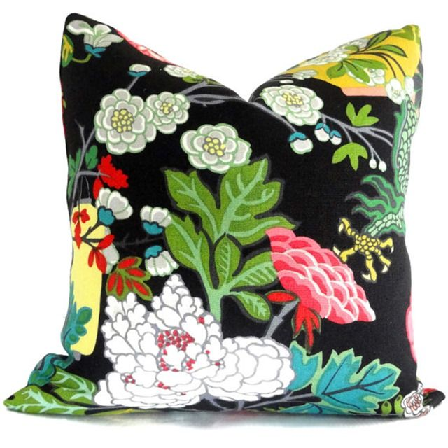 a colorful, floral pillow in Chiang Mai Dragon fabric