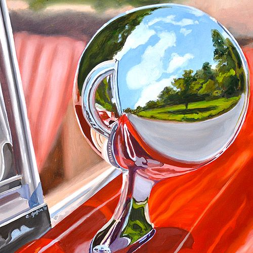 reflections in the side mirror on a red '66 Mustang