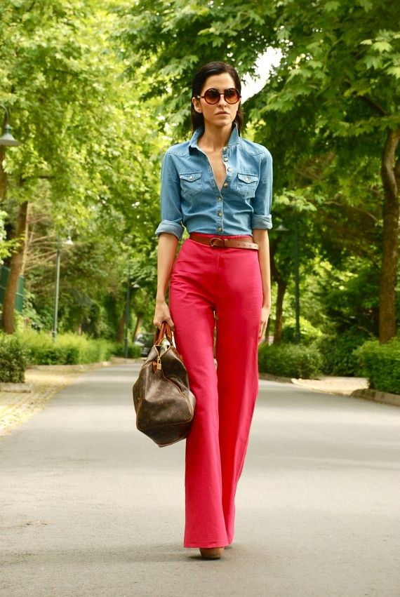 """Okay, so MAYBE this color combo isn't the best, but just look at the fit of those pants!  Try pairing a high-waisted, flared pant like these in black, with a button-down in a fun color like coral or mint.  It will minimize your hips, balance your figure, and elongate your legs.  Throw in some fun heels and """"Victoria's secret"""" curls, and tear up the town!"""