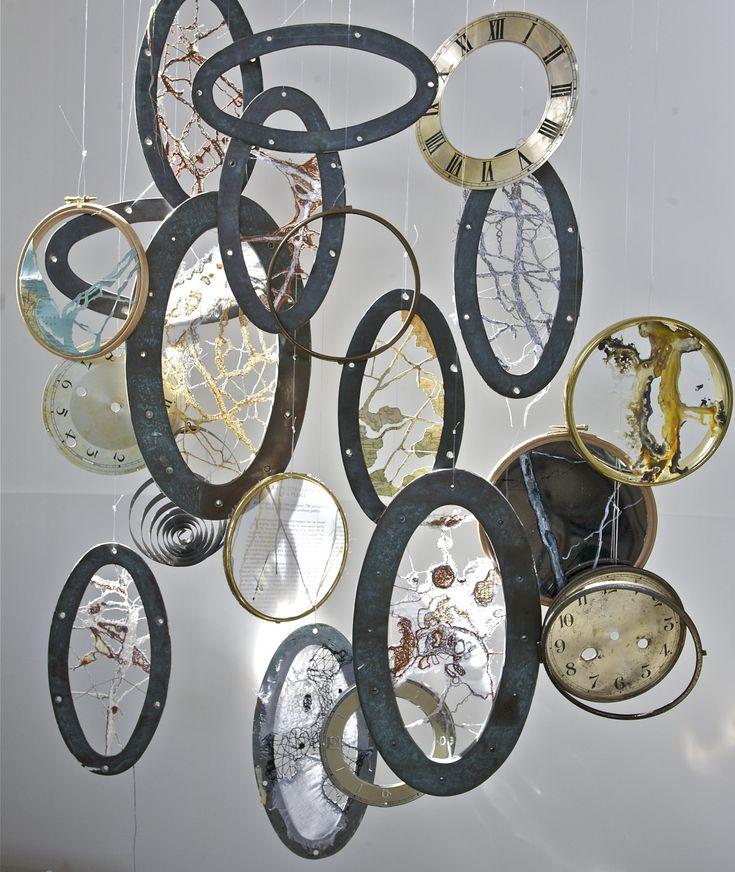 pebbles - Janilaine Mainprize.  beach pebbles. maps. port-holes. thread. textile. installation.