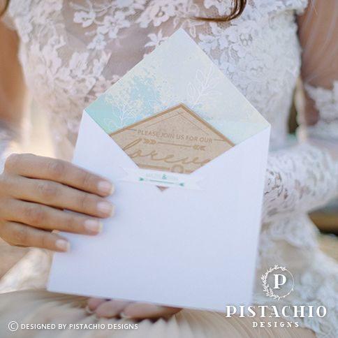 Stunning wood engraved wedding invitation with a beautiful pastel envelope liner made by www.pistachiodesigns.co.za