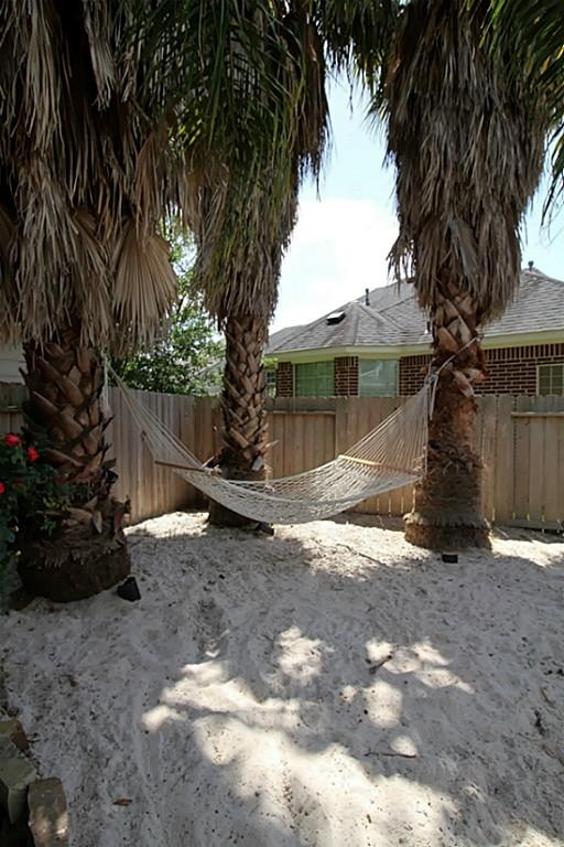 Man Made Beach Area Perfect For Relaxing In A Hammock Or
