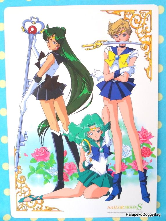 A shitajiki / illustration picture board for the Japanese shojo anime, Sailor Moon. The stationery item with the illustration of the pretty guardian soldiers, Sailor Pluto, Sailor Neptune and Sailor Uranus is for Sailor Moon S.