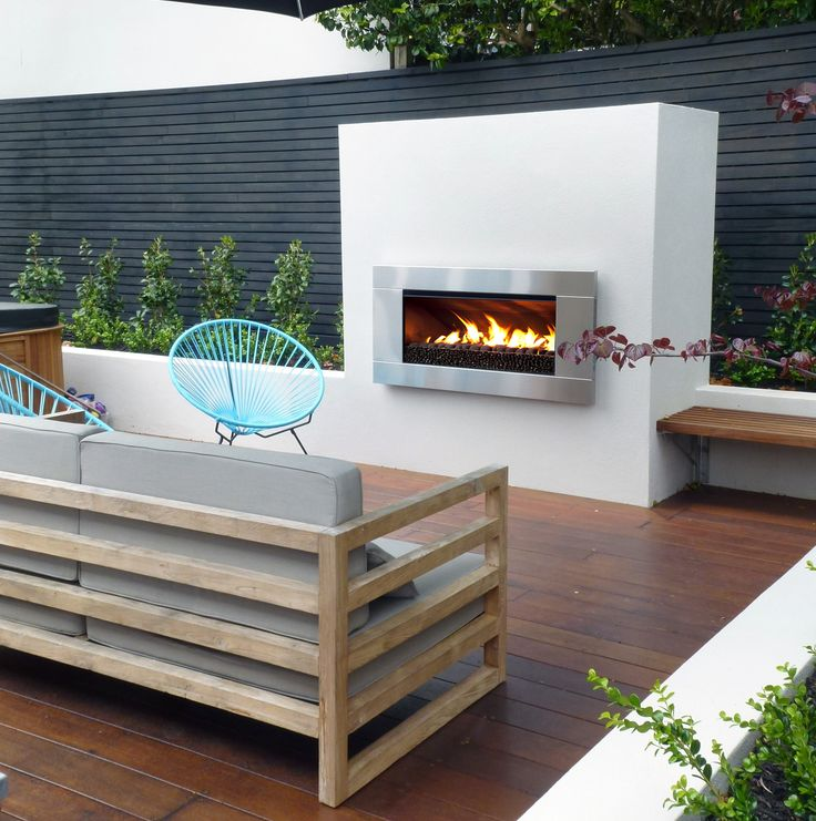 Escea EF5000 outdoor gas fireplace with black coals.