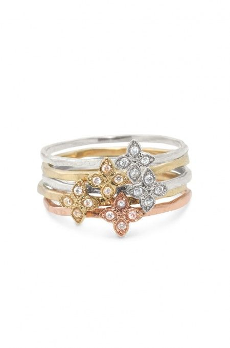 I love these rings!  So cute and will match everuthing!!   Add style with delicate mixed metal flower stackable band rings from Stella & Dot. Find fashion rings, cocktail rings, vintage rings, bands & more.