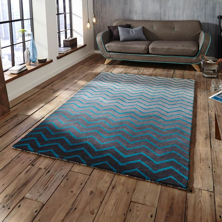 The Spectrum Rug Is Handmade In India With A Thick Soft Wool Pile This Stunning Blue Chevron Design On Graduated Grey Background Offer High Levels Of