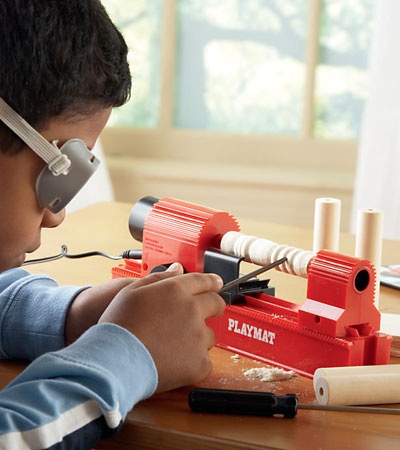 Cool 4-in-1 Woodshop Tool 84.98 this little gadget is a working jigsaw, lathe, drill press and sander. The safety goggles are separate (4.98)--most kids who are ready for this probably have their own already.  There are also sets of pre-sized wood and extra parts (blades, sanding disks, etc.) for under 20.00  I wouldn't let a kid near a real lathe, but this one has unnamed safety features and *looks* safe enough to use with caution and supervision.