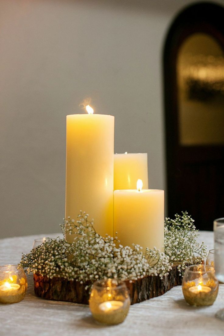 Without the rustic part...  I love the three big candles with the baby's breath and the smaller candles around. This with rose pedals scattered... Or maybe just lace doilies underneath.