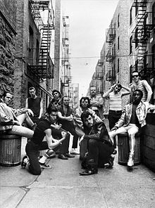 "Sha Na Na is an American rock and roll group. The name is taken from a part of the long series of nonsense syllables in the doo-wop hit song ""Get a Job"", originally recorded in 1957 by the Silhouettes.[1]"