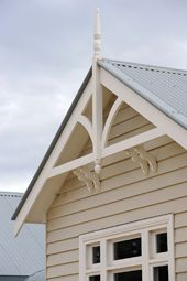 Grandview Farm Homes - Victorian Eaves, Gable brackets and finials complete the authentic facade