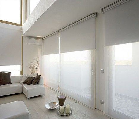 Double roller blinds   Remodelista - 3 double roller blinds; sheer blinds during the day filter and diffuse light, blackout blinds keep the room dark at night.