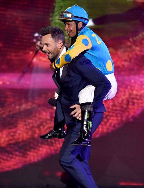 The 2015 ESPYS -  Host Joel McHale (L) and jockey Victor Espinoza walk onstage during The 2015 ESPYS at Microsoft Theater on July 15, 2015 in Los Angeles, California.