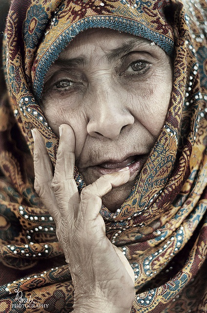 what a knowing face - as though this woman has seen it all and survived, by Norah Mohammad