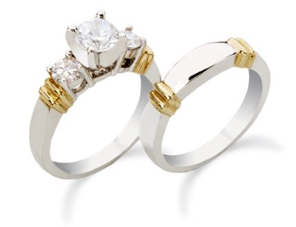 White and yellow gold engagement ring featuring a round center diamond, side diamonds and matching wedding band.