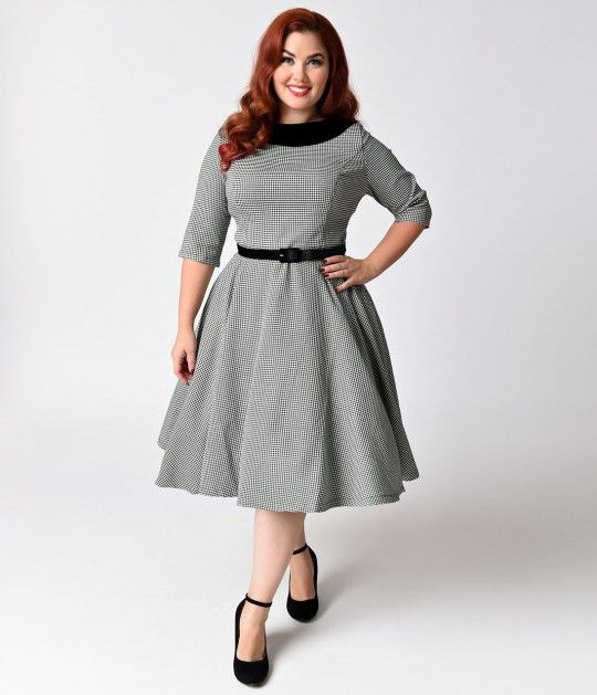 We are for real, gals! A glamorously plus size retro inspired dress steeped in a glorious houndstooth, The Jackson Dress from Hell Bunny is a lightweight black and white frock with a stunning black velvet collar. Featuring elegant half sleeves and a princ