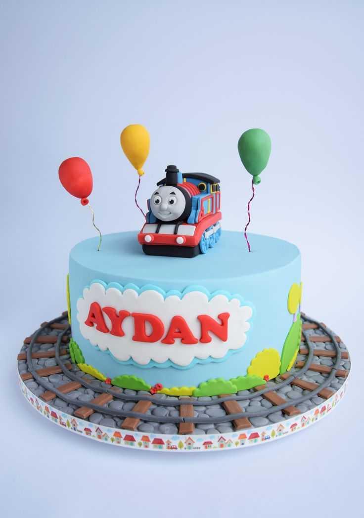 Thomas the Tank Engine cake (put train on tracks, and age on top)