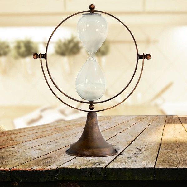 Our metal hourglass is a vintage hourglass reproduction with vintage charm. Use this hourglass timer in your study space, kitchen, or foyer! For more visit, Decor Steals