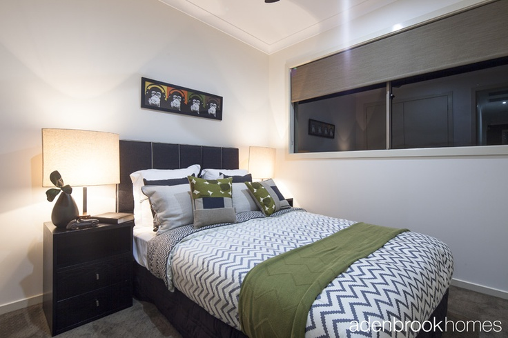 Bedroom decorated in olive and grey on a canvas of charcoal.