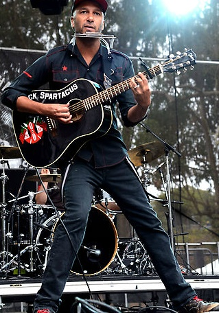 Tom Morello - I don't always agree with his political opinions and anarchistic ways, but he is one helluva guitarist & performer!