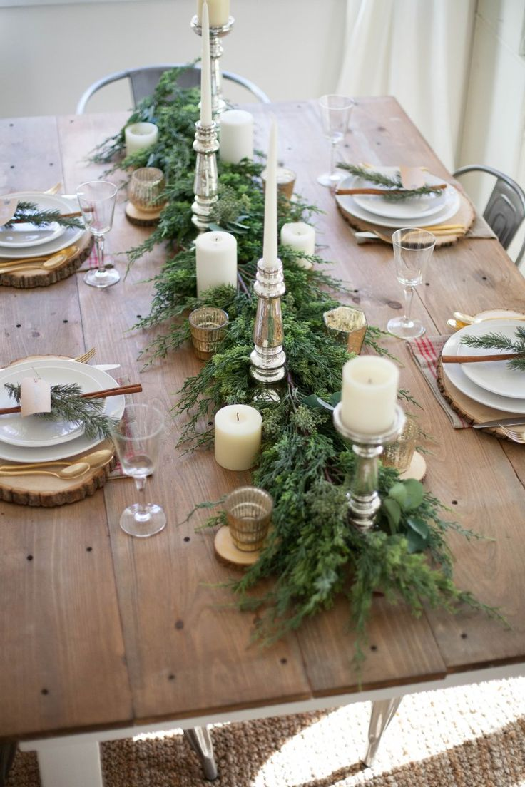 Elegant christmas table decorations - A Beautiful Farmhouse Christmas Tablescape With Rustic Elements Mixed Metals And Natural Greenery