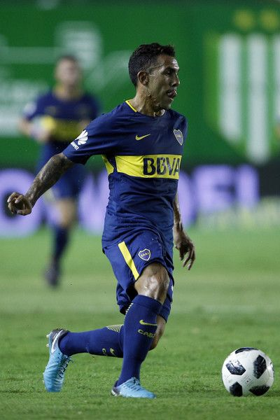 Carlos Tevez Photos - Carlos Tevez of Boca Juniors drives the ball during a match between Banfield and Boca Juniors as part of Argentina Superliga 2017/18  on February 18, 2018 in Buenos Aires, Argentina. - Banfield v Boca Juniors - Superliga 2017/18