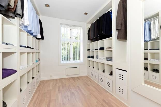 SPACE: WALK-IN WARDROBE. Love this Expedit Walk-In-Closet from IKEA Hackers. I'd add a trolley island in the middle of the room for jewelry.