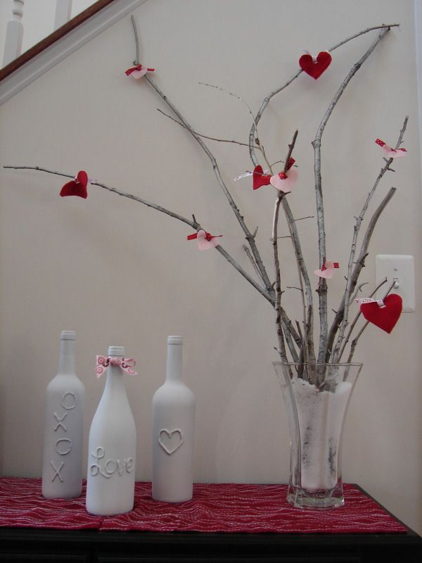 DIY wine bottle valentines day decoration :: just took the christmas bulbs off my branches - easy to put these hearts on it.