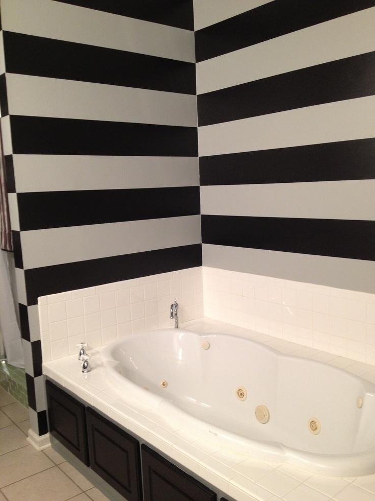 Stripe walls....horizontal stripes makes my tall bath look huge!