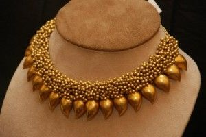 Gold necklace with gold beads and mangoes by Amarapali