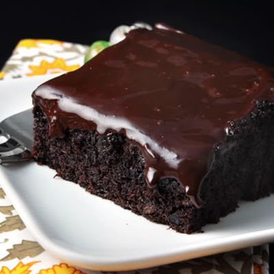Deep, dark and delicious… you'll be surprised at the secret ingredient used in this super moist and uber-fudgy chocolate cake!