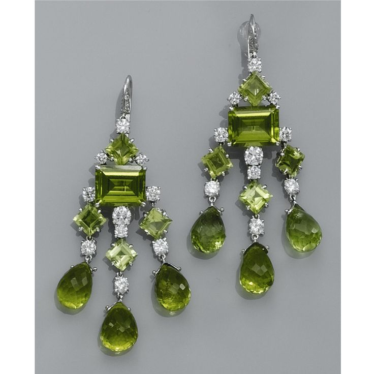 Peridot Chandelier Earrings: A PAIR OF PERIDOT AND DIAMOND EARRINGS Of chandelier design, set throughout  with peridots and,Lighting
