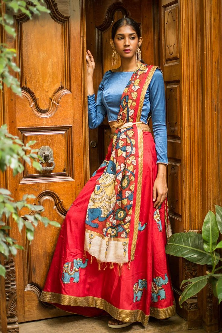 Yet another super chic, Kalamkari detailed number! With all over elephant motifs in Kalamkari and a subtle sequinned border. We are just LOVING this number.This lehanga is paired with a cool Kalamkari duppatta edged with a sequinned border to complete your look.We paired this one with a blue full sleeved blouse in lycra…Pair it with a blue blouse or even a maroon blouse to look just as cool! #kalamkari #saree #india #blouse #houseofblouse