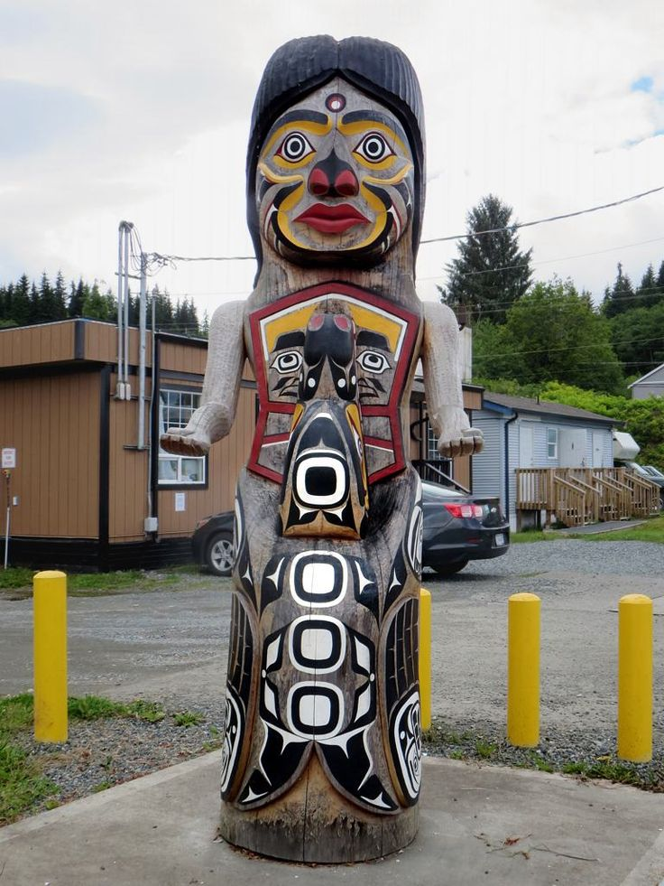A Quatsino totem pole overlooks the wharf at Coal Harbour on northern Vancouver Island, British Columbia, Canada.