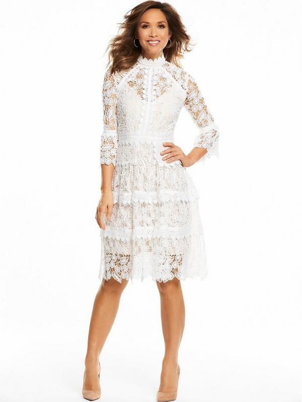 Myleene Klass Lace Midi Dress Get your occasion wardrobe sorted this summer in this stunning lace midi dress by Myleene Klass! With a nude underlay protectingyour modesty, the sheer white lace dress with scalloped hem and beautiful three-quarter sleeves flows elegantly about your silhouette.Finish in a pair of pointed courts and a flick of eyeliner. Perfect!